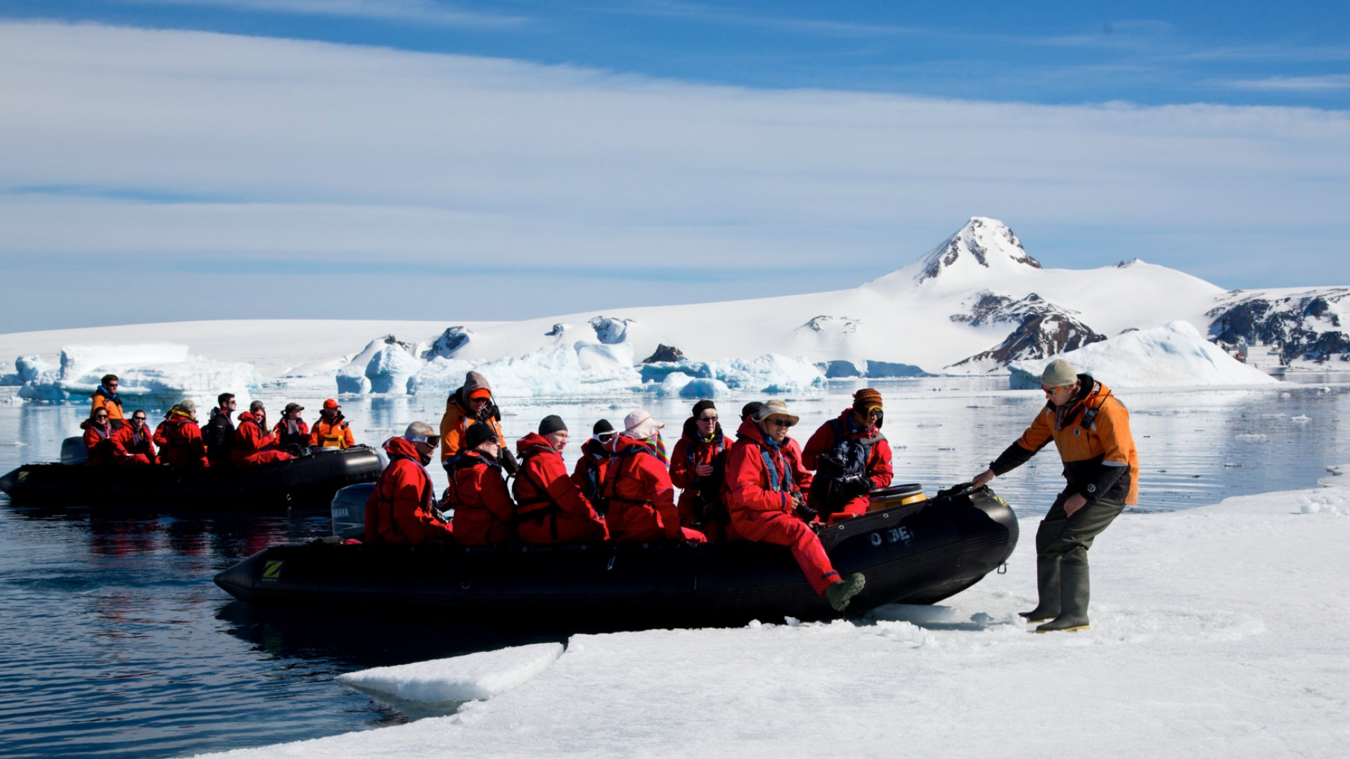 zodiac with people in antarctica