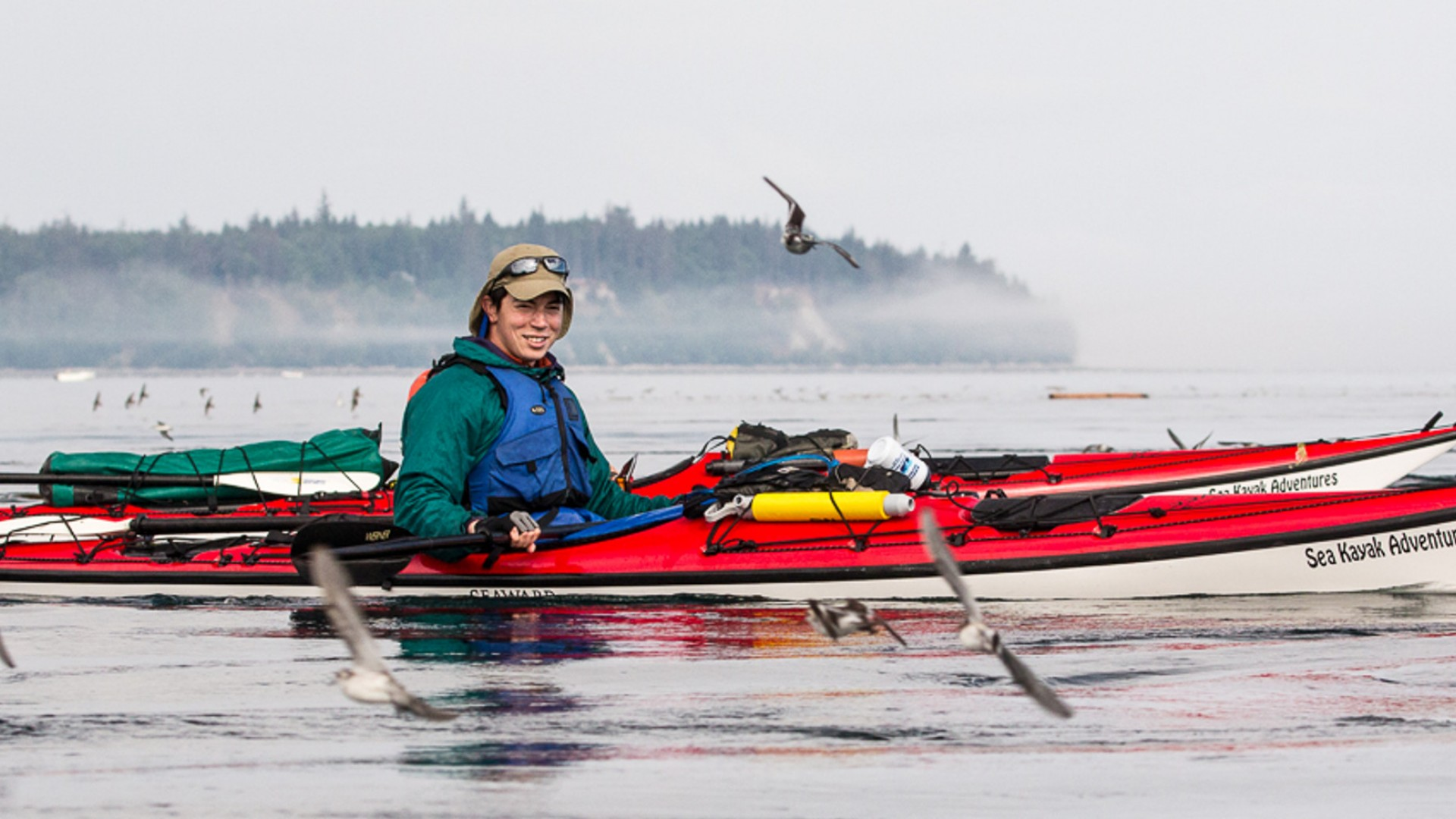 man in kayak in johnstone strait