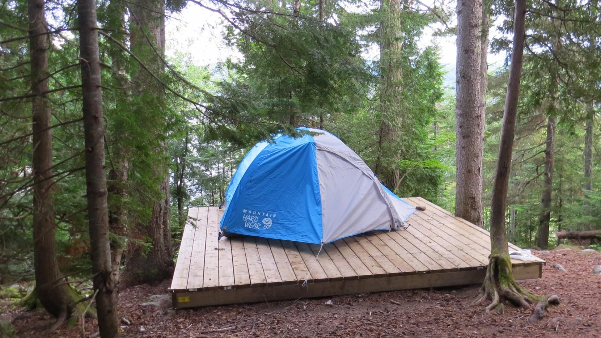 Tent on a platform in Quebec wilderness