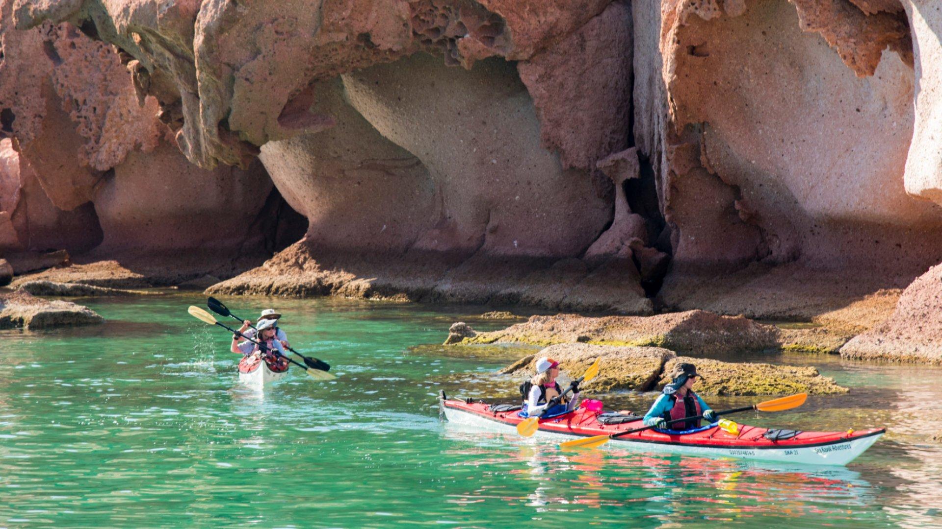 kayaks in front of rock formations along espiritu santo