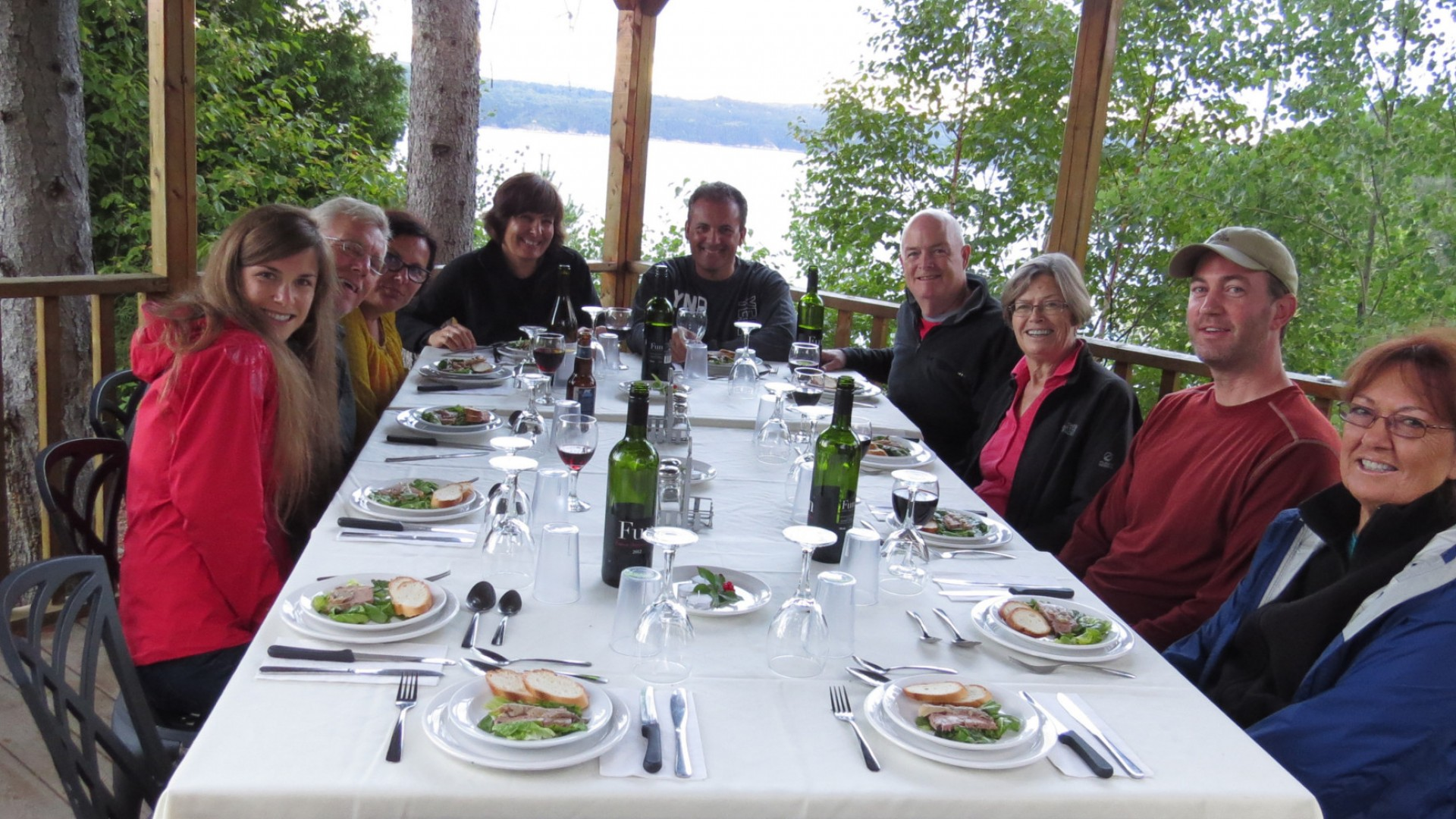 travel group eating dinner at table together