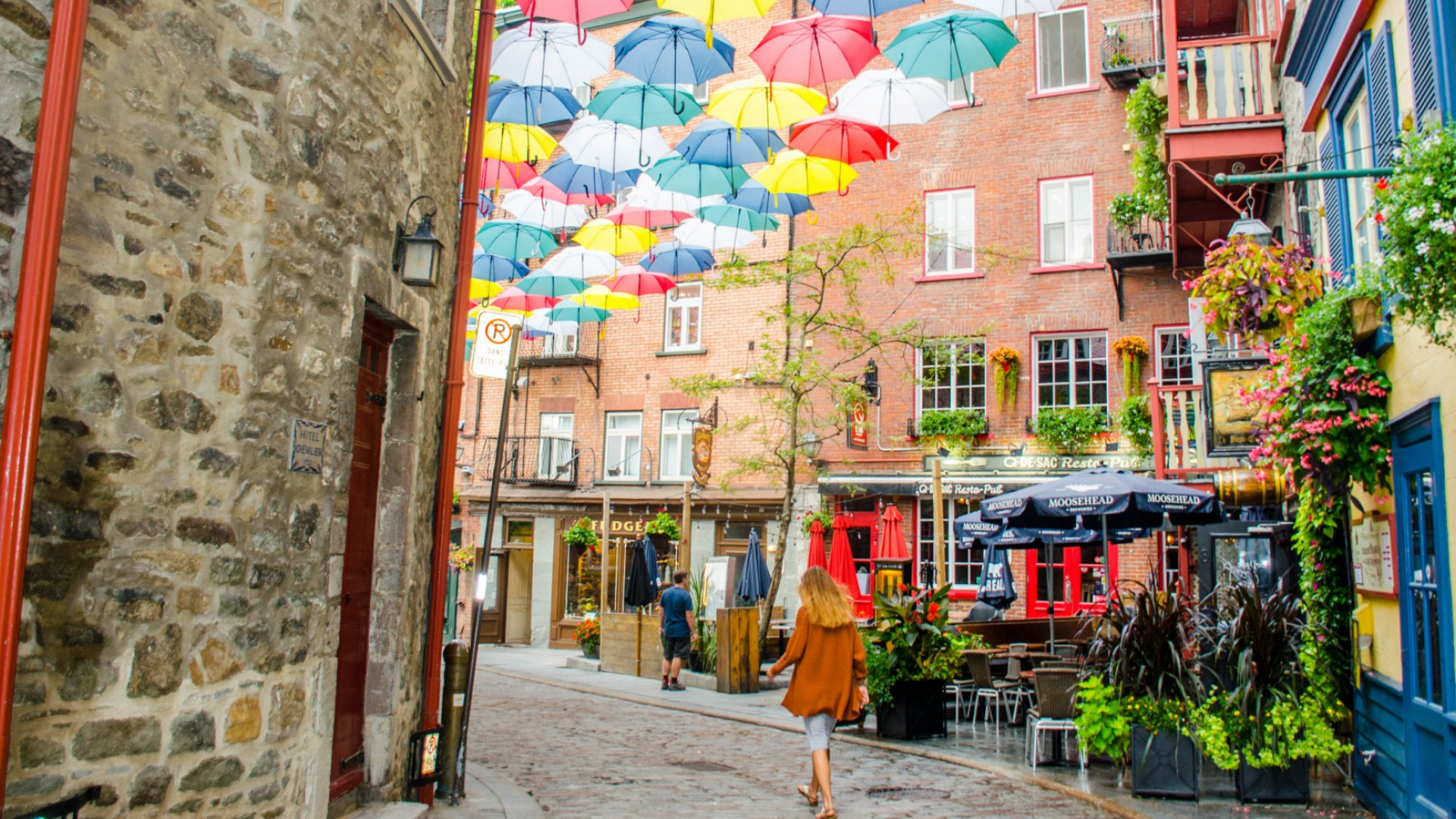 umbrellas hanging above street in quebec