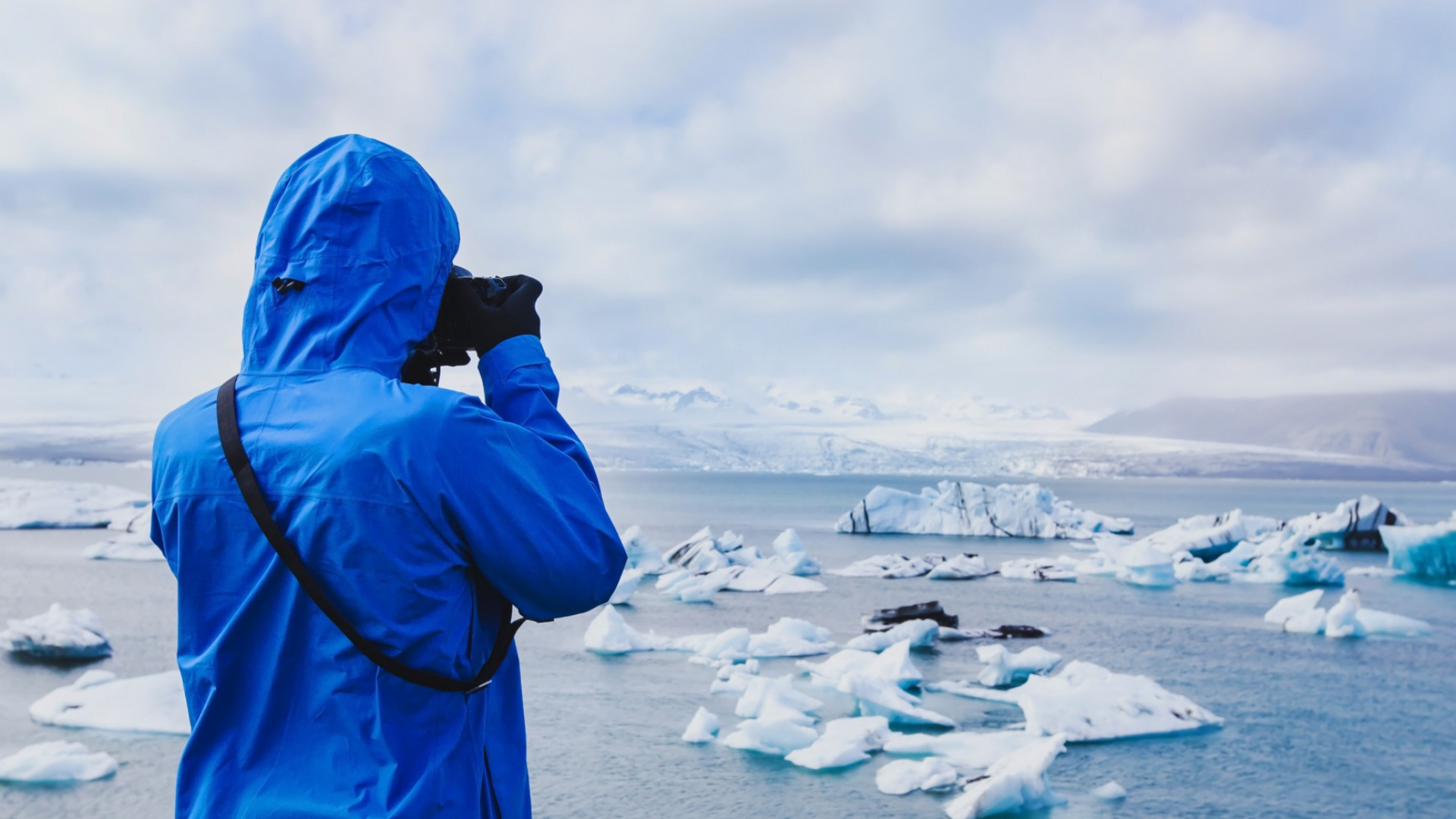man taking photographs in the arctic