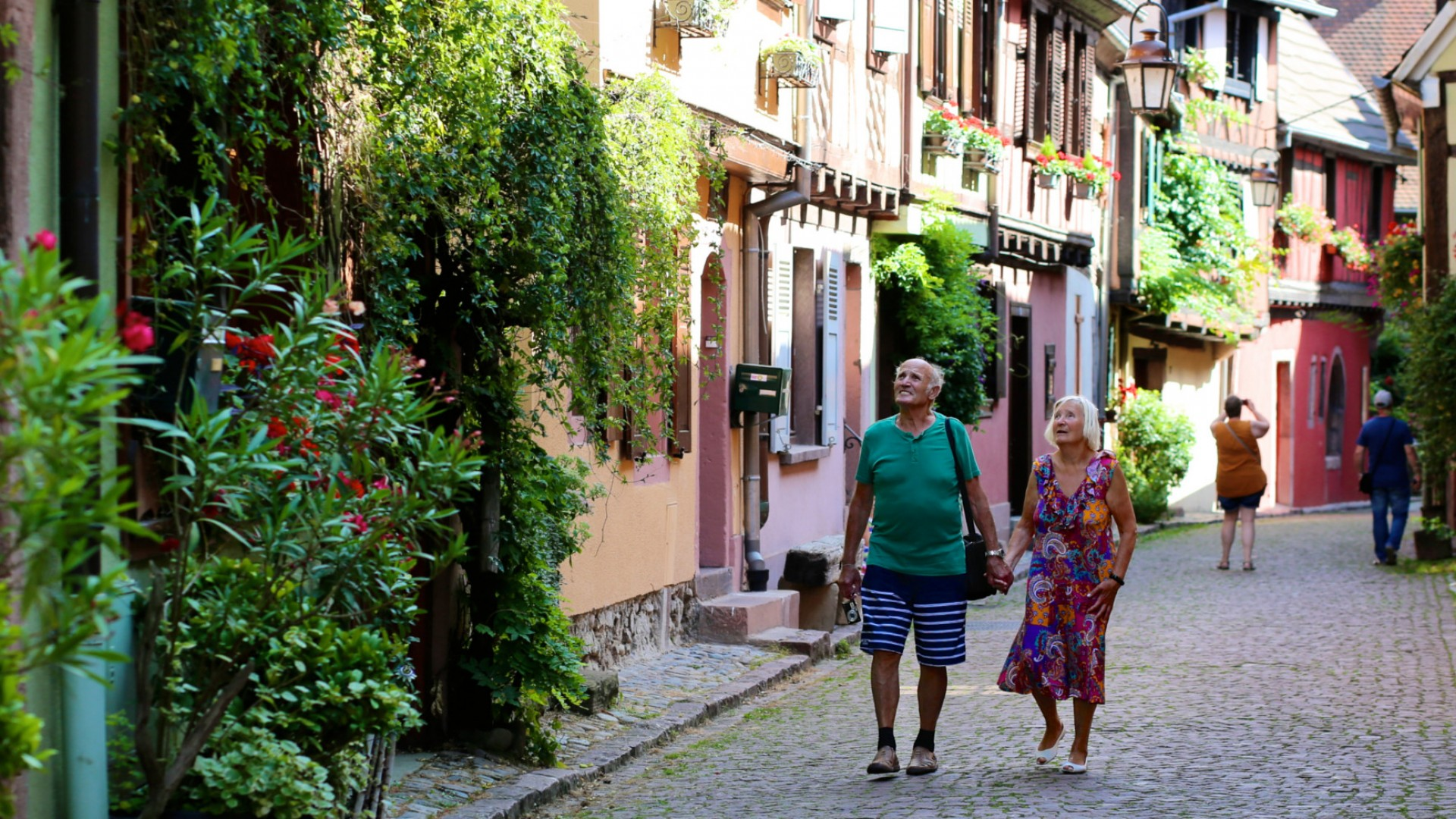 couple strolling the streets in france