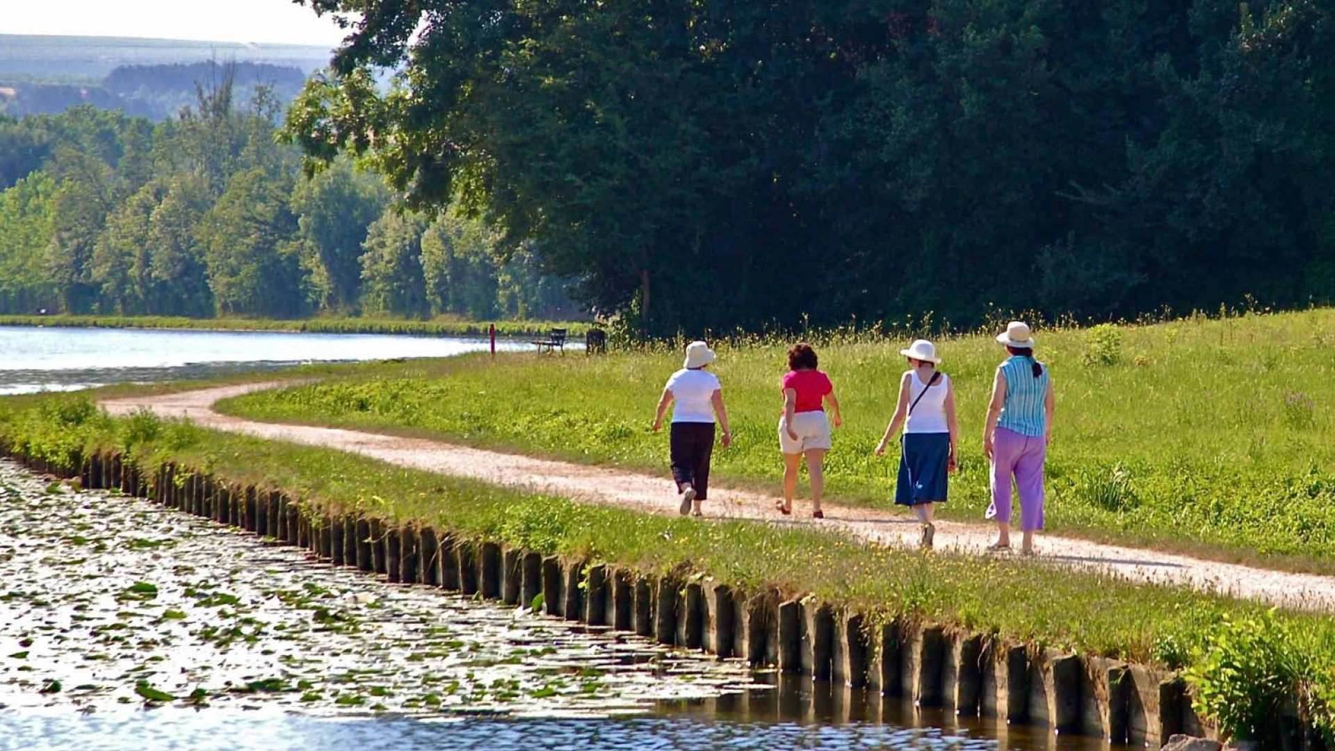 people walking along a French canal
