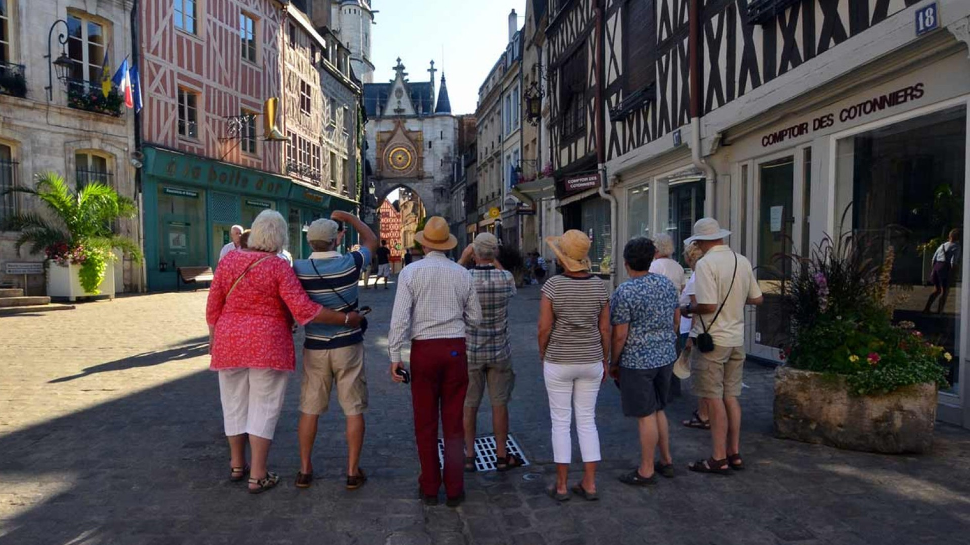 people on walking tour of french town