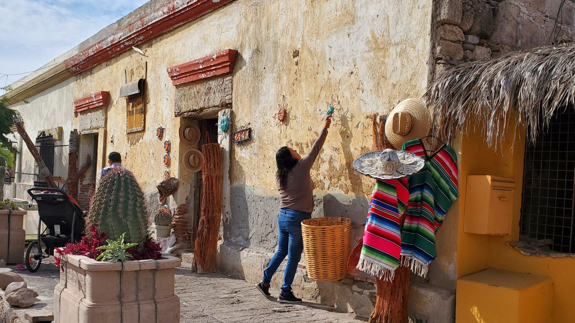woman in front of market in loreto baja