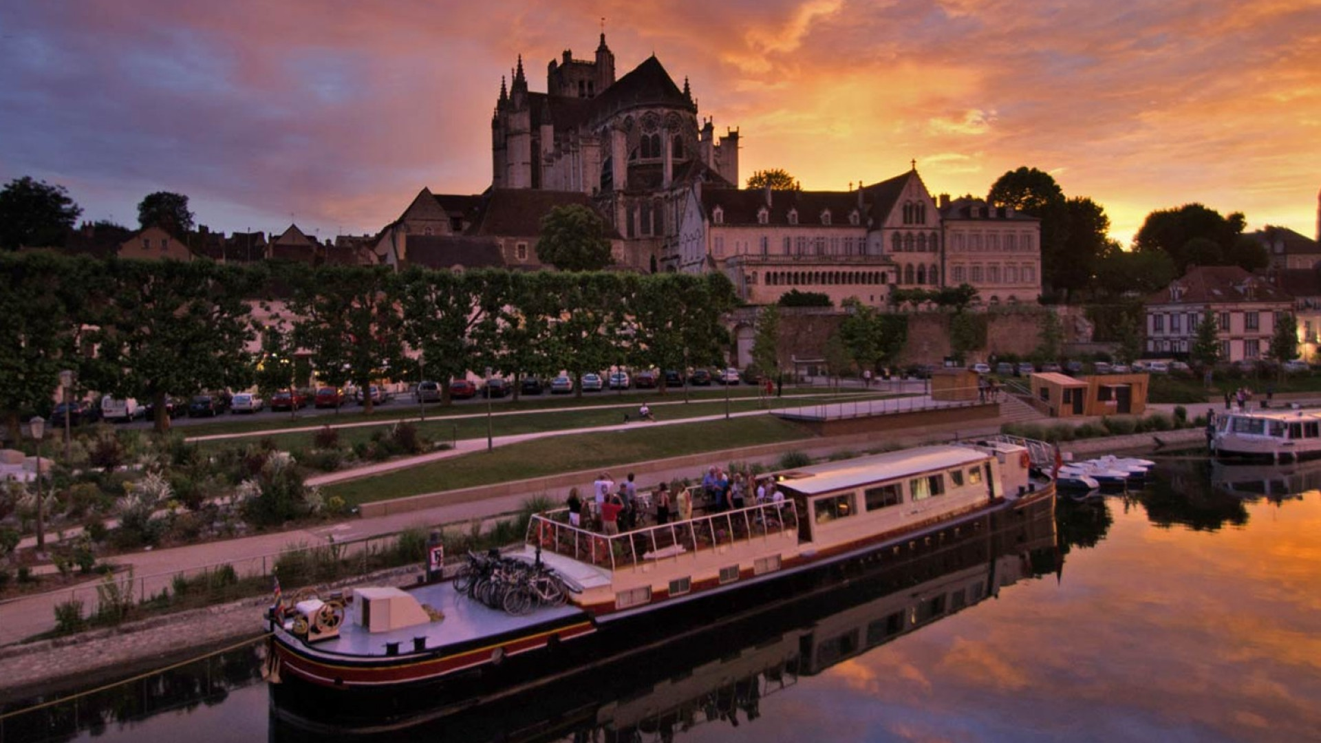 luxury barge in france at sunset