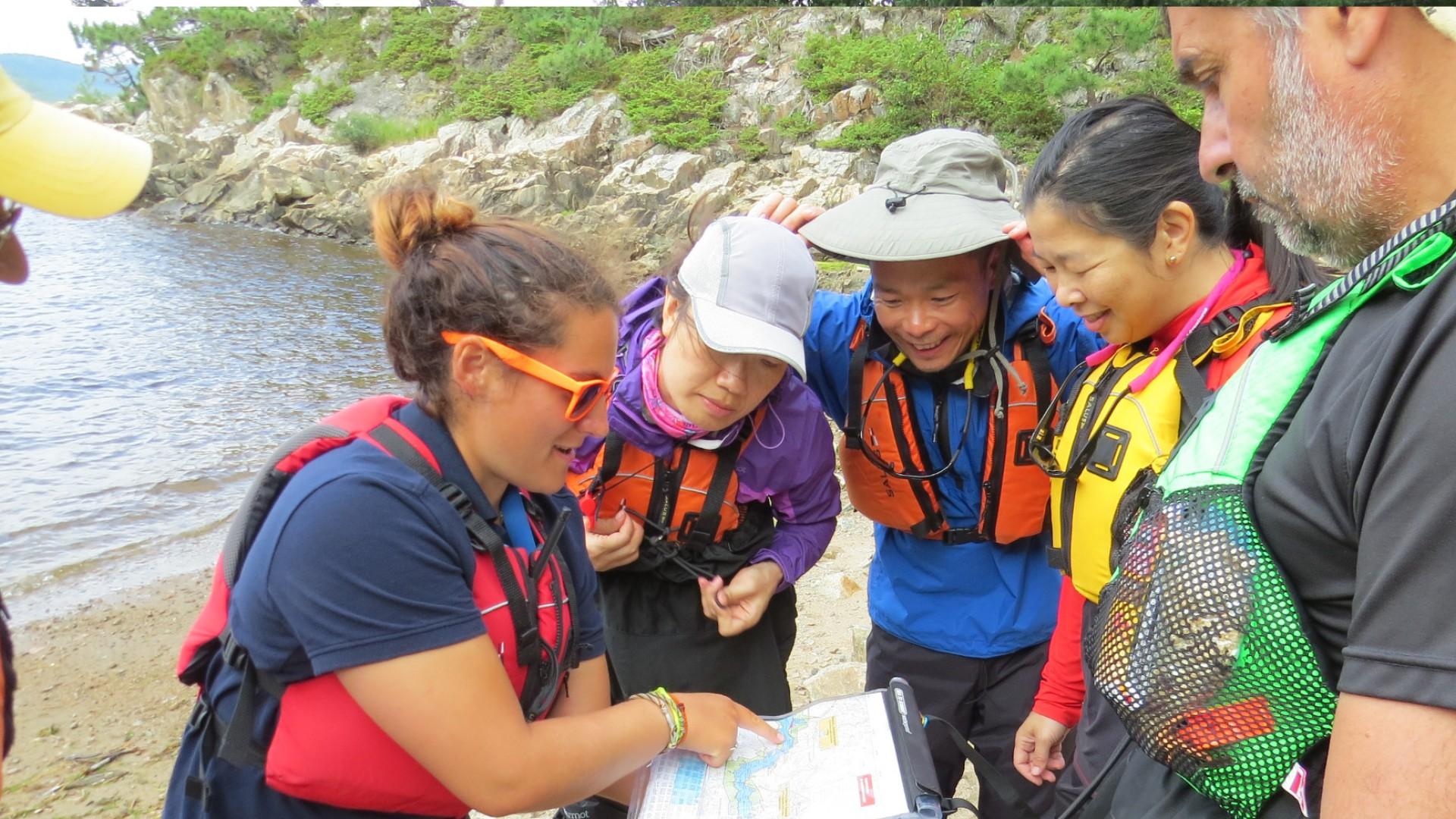 kayakers looking at a map