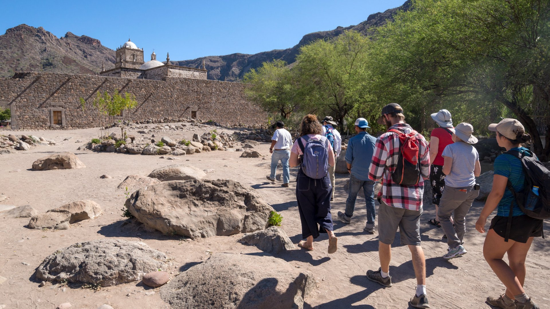 people touring the san javier mission in baja