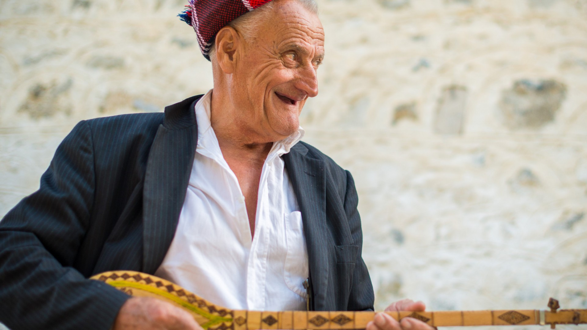 man playing an instrument in albania