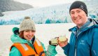couple drinking during iceberg tour in patagonia