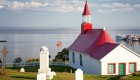 white church with red roof in Tadoussac Quebec