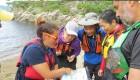 Group of sea kayakers look at a map